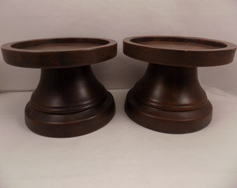 Vintage Faux wood grain pedestal candle holders. Only place candle on top heat resistant portion of pedestal. Heavy solid possibly resin.