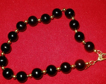 BLACK BEADED BRACELET by Monet