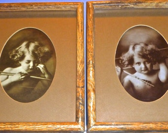 Pair of photographic prints; Cupid Awake/Cupid Asleep