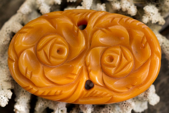 Orange Oval Floral Bakelite Pin