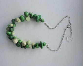 Lightweight woven necklace beads in various shades of green