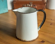 Vintage enamelled off-white pitcher