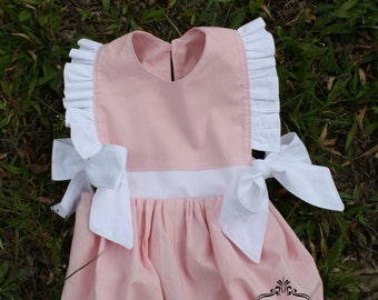 Pink and white bubble romper with flutter sleeves and big bow ties