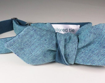 Cotton+Linen yarn-dyed chambray bow tie in light blue & royal blue... reversible over  English wool in blue back blades. Slim adj self-tie.