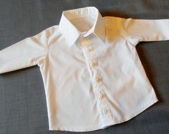Infant or Toddler long sleeve, white dress shirt. White button down shirt in sizes NB-3 months, S, M, L, and XL. Also available in black.