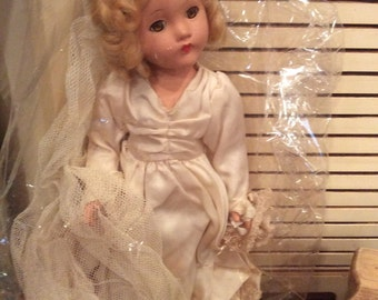 Vintage Bride doll with gown, bouguet and veil.  Eyes open and close!