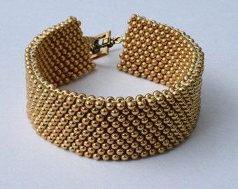 Gold Color Peanut-Shaped Glass Bead Beadwoven Cuff Bracelet