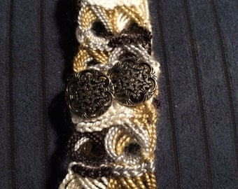 Broomstick lace cuff bracelet with two metal buttons