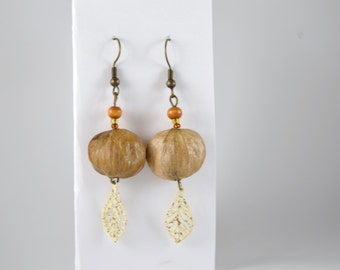 Hand-made hickory nut earrings with metal painted leaves