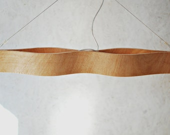 The Eyes, hanging lamp made from bent plywood.