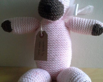 Pink and brown teddy with ribbon.