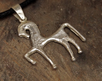 Ancient greek horse's shaped silver pendant