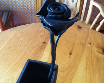 Wrought iron blacksmith made Rose. Forged metal rose with leaf stem.