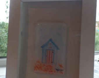Beach hut pictures in white frames