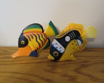 Pair of brightly colored wooden tropical fish from the early 1990s, can be posed two ways