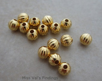 100 corrugated gold plated 4mm round beads