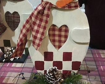 Handmade wooden primitive snowmen