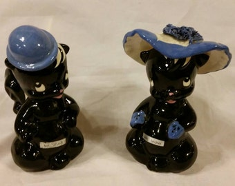 Ceramic Mr and Mrs Skunk planters