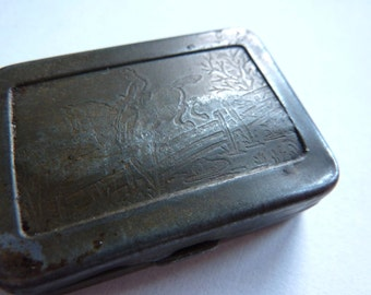 a small vintage french tin, rubber stamp, ink pad