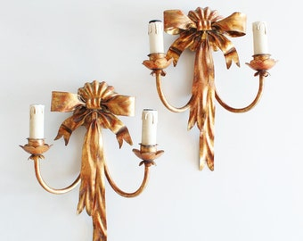 Beautiful pair of wall sconces. Gilt forging. Retro vintage style.
