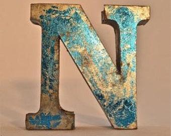 A fantastic vintage style metal 3D blue letter N