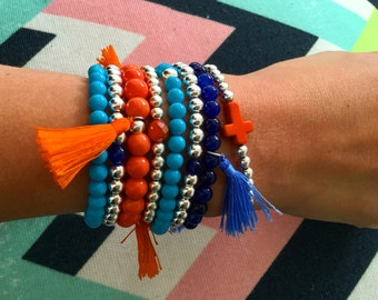 The bohemian bracelet stack. Orange, blue and silver beaded bracelet stack. Tassel bracelet stacks.
