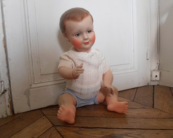 A French vintage celluloid Petitcollin baby doll