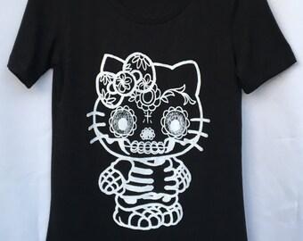 Kitty Black Day of the Dead Skull T-shirt. Cat Skull T-shirt. Calavera Gato T-shirt. Dia de los Muertos T-shirt. Gift Friendly.