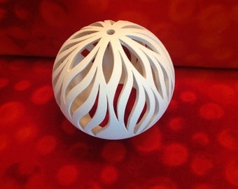 Flame lights ball clay