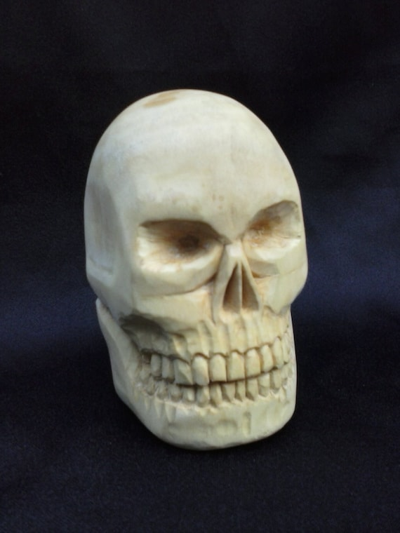 Carved wood skull sculpture hand wooden in