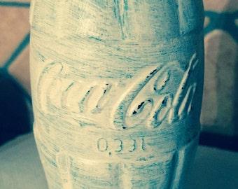 Glass jar by Coca Cola bottle