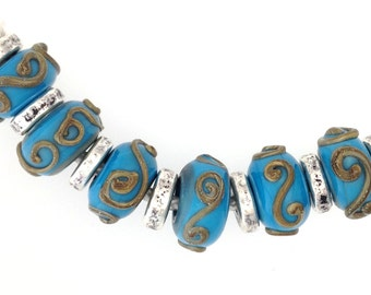 Handmade Glass Beads - A Set of 6 Handmade Turquoise Glass Beads with 7 silver ceramic Greek spacers