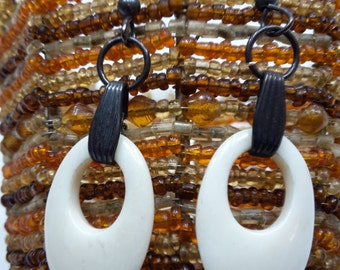 "Earrings dangle "" sterling and oval bone donuts"""