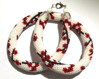 Necklace style tow