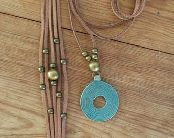set of pendant and bracelet of leather and bronze
