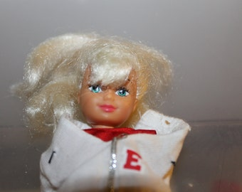 This doll has Blonde Long Hair that was in a PonyTail, White Jacket w The Letter E, Red Shirt, Yellow Skirt, Very Pretty, Gift, Barbie Like