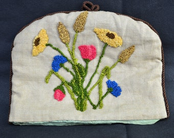 Vintage embroidered tea cosy