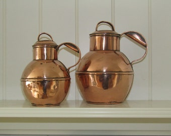 Two Vintage Copper Milk Jugs
