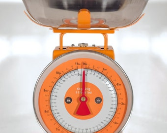 Orange vintage-retro kitchen scale.