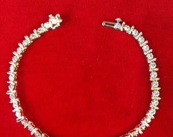 14 K Yellow Gold Beautiful Tennis Bracelet With 42 Small Diamonds. 7.6 gm.