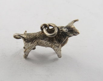 Sterling Silver Charm of a Bull.