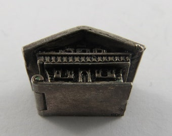 A Two Story Lodge Sterling Silver Charm.