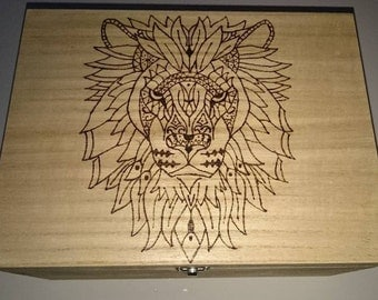 Lion Handcrafted wood burning on a large wooden box.
