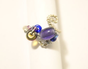 Twisted Silver Ring with Purple Beads
