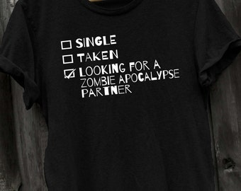single taken looking for a zombie apocalypse partner funny tshirt