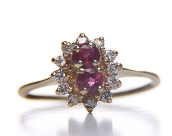 14 kt gold diamond and ruby ring. Size 9
