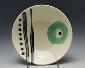 Handmade white ceramic serving bowl by Potteryi. Modern bowl with black stripes and green circle gift pottery.
