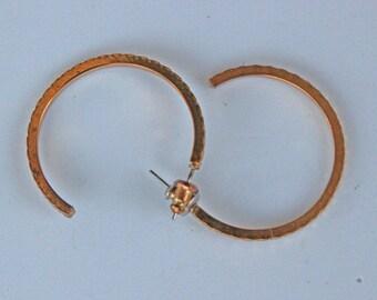 Slender gold hoop earrings