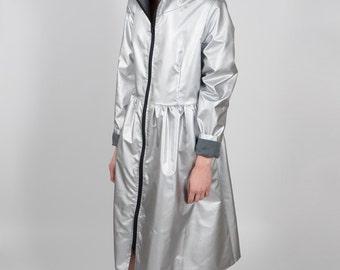 Silver raincoat in a shape of a dress