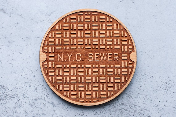 Wooden coaster new york manhole cover